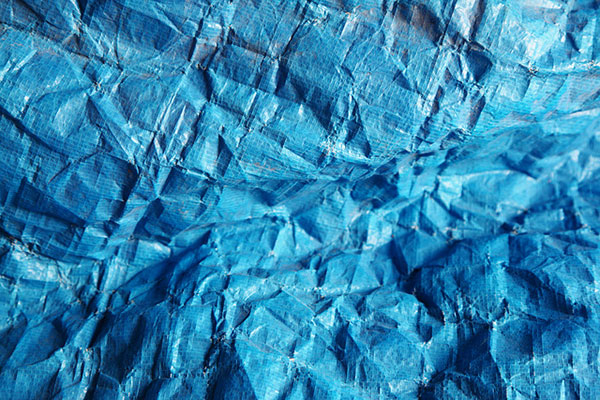 Blue wrinkled tarp. Photo by Pink Sherbet Photography
