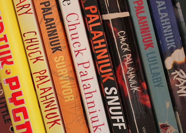 Chuck Palahniuk books on a shelf