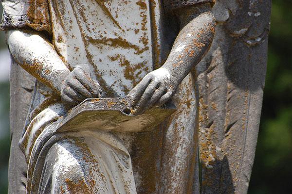 Statue hand writing. Photo by Marsha Brockman/Flickr