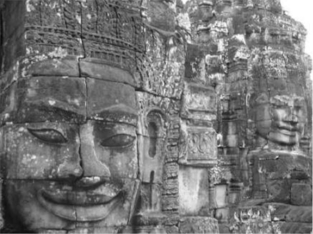 Stone faces in Cambodia. Photo by Tammy Ho.