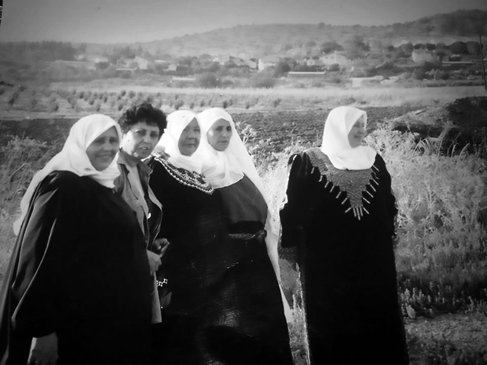 The author's mother, Sirryeh (third from left), visits the ruins of Zakariyya with her sisters, daughter, and cousin. Photo by Jihad Mashal.