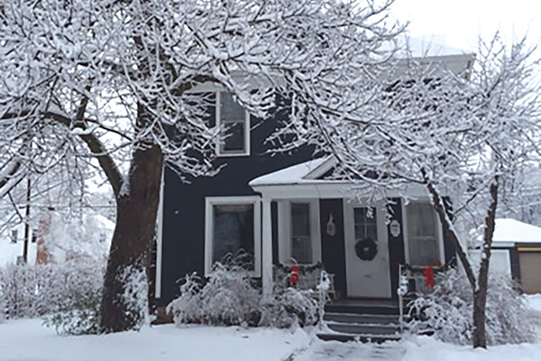 A house covered in snow.