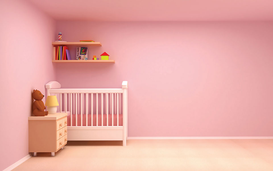 A bedroom with bubblegum pink walls.