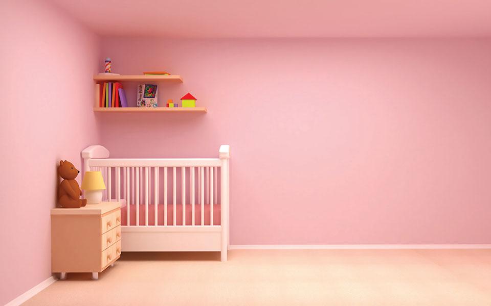 A bedroom with bubblegum pink walls.