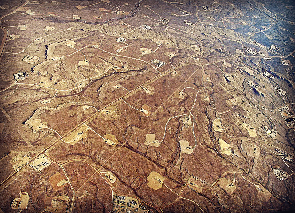 An aerial view of hydraulic fracturing in progress at Jonah Field in Wyoming.