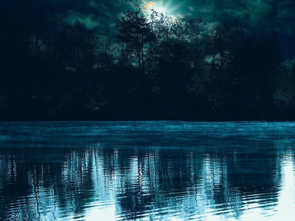 A lake reflecting moonlight at night