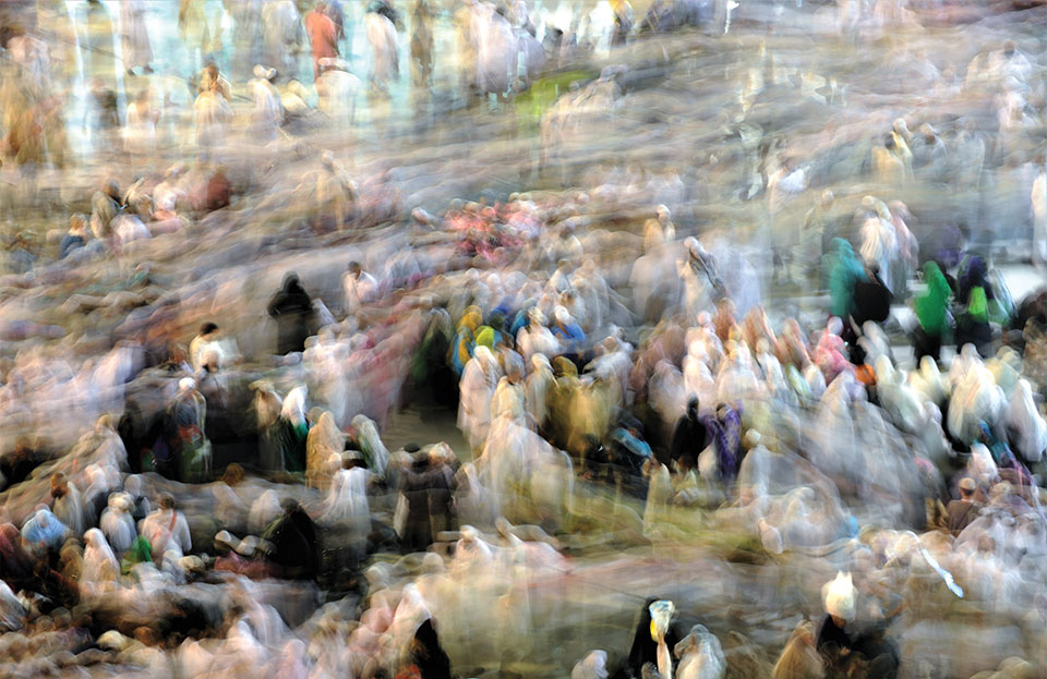 A photograph featuring many people that is blurred to create the effect of an Impressionist painting