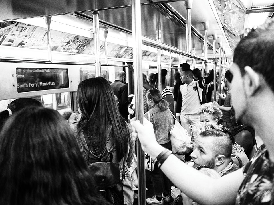 People on a crowded NYC subway. Photo: Jason Devaun