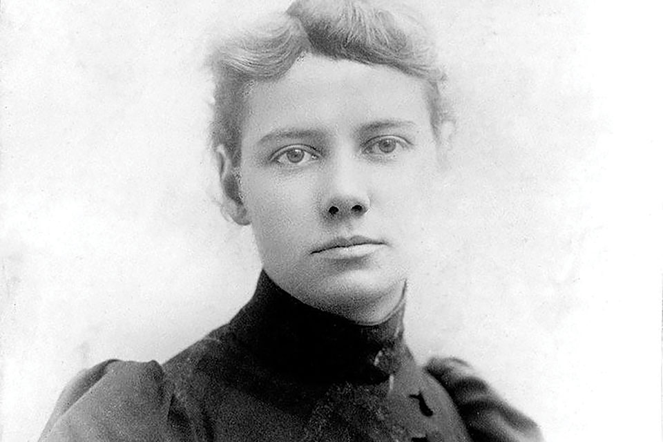 A black and white photograph of Nellie Bly, a pioneering female reporter.