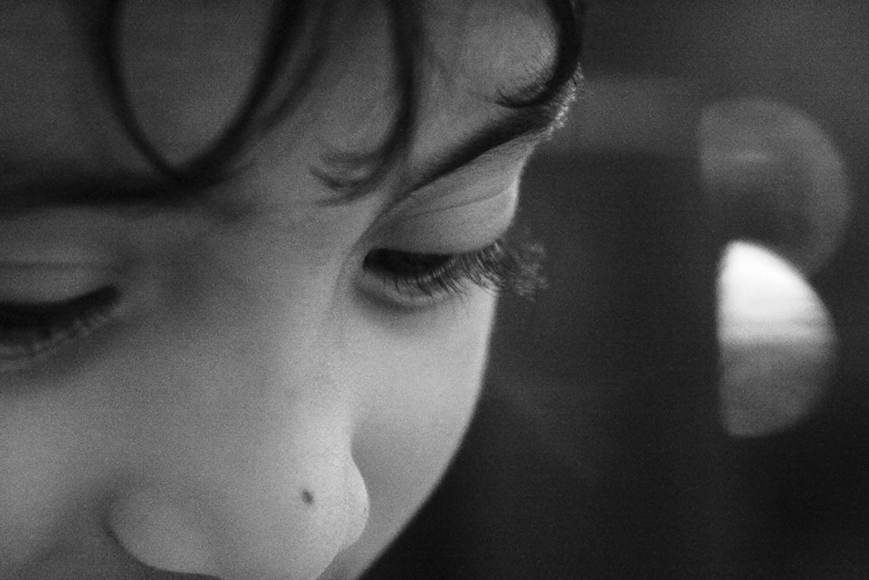 A black and white photograph close-up of a child's face