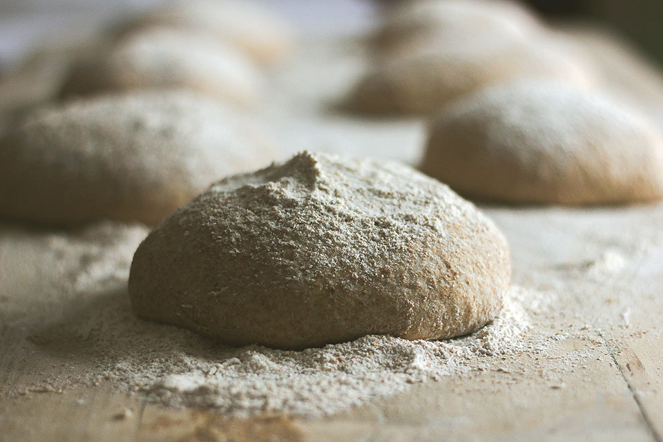 Lumps of worked dough, covered in flour