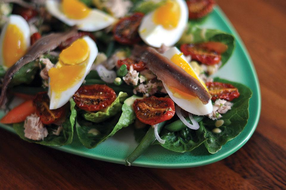 A close up photograph of a Nicoise salad