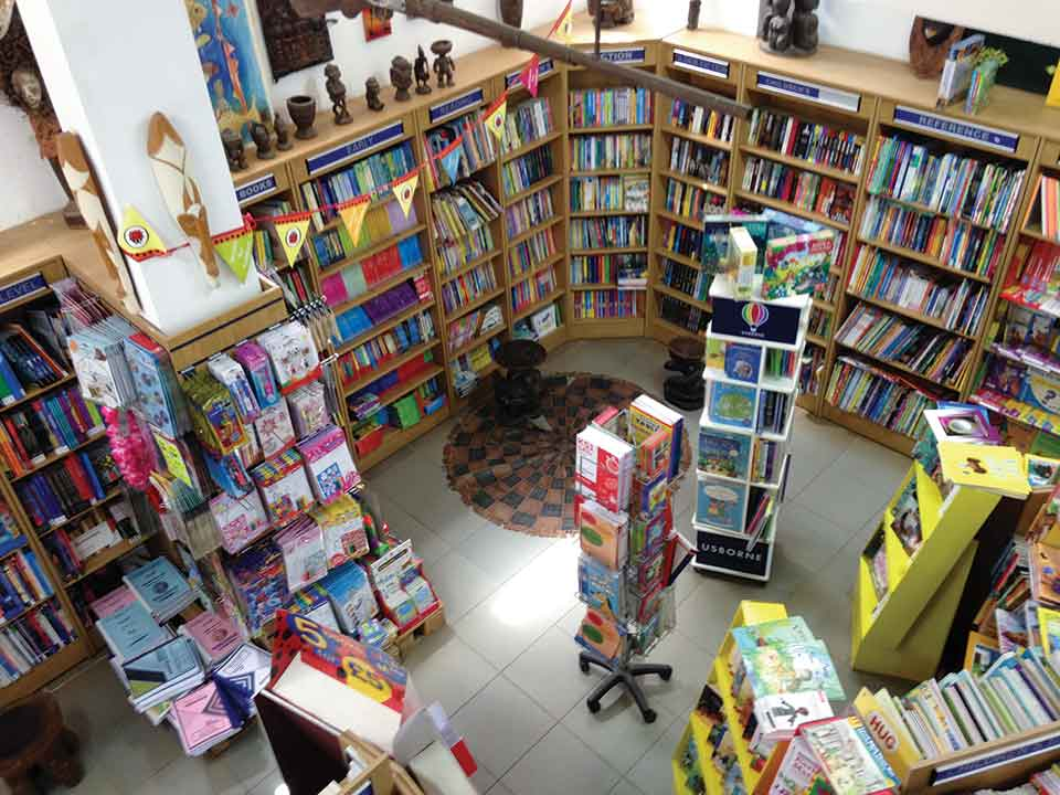 A photograph of a robustly stocked bookstore from above