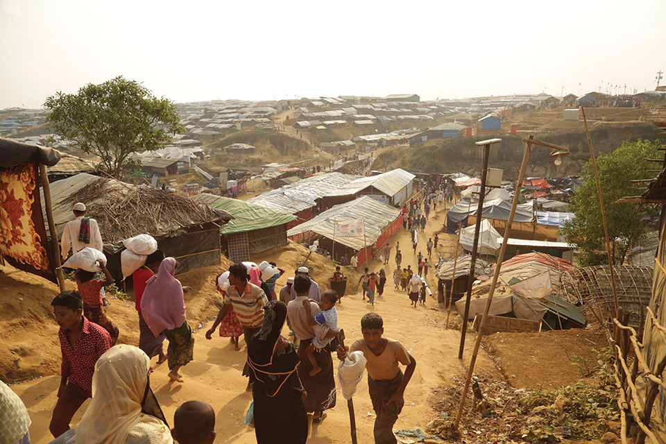 A shot from from a hill near Kukupalong refugee camp near Cox's Bazaar, Bangladesh of refugees streaming in and out of the camp