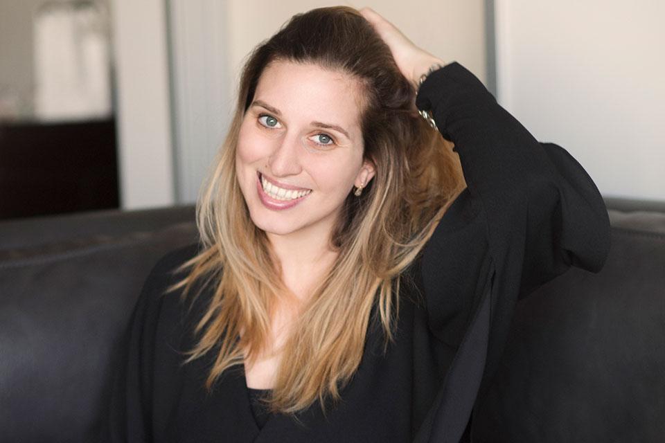 A photograph of Amber Ambrose Aurèle, smiling