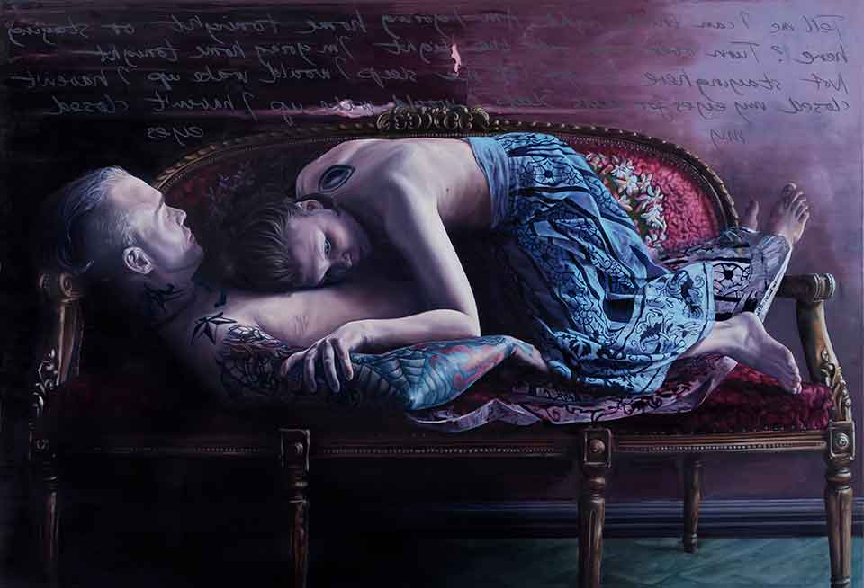 Two figures lie on a small couch