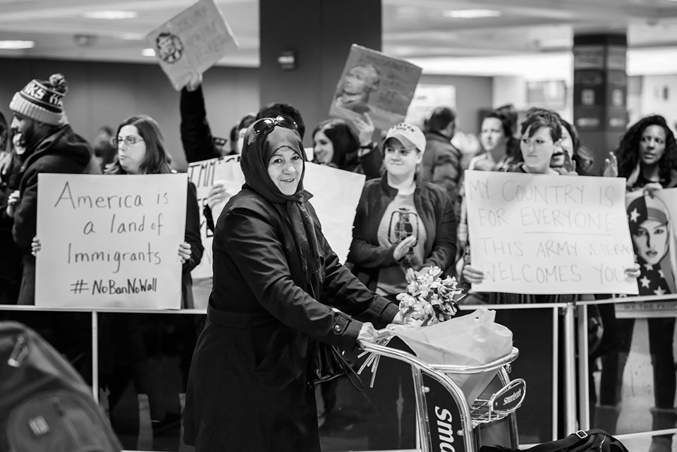 An immigrant in the Dulles International Airpot, Jan. 28, 2017.