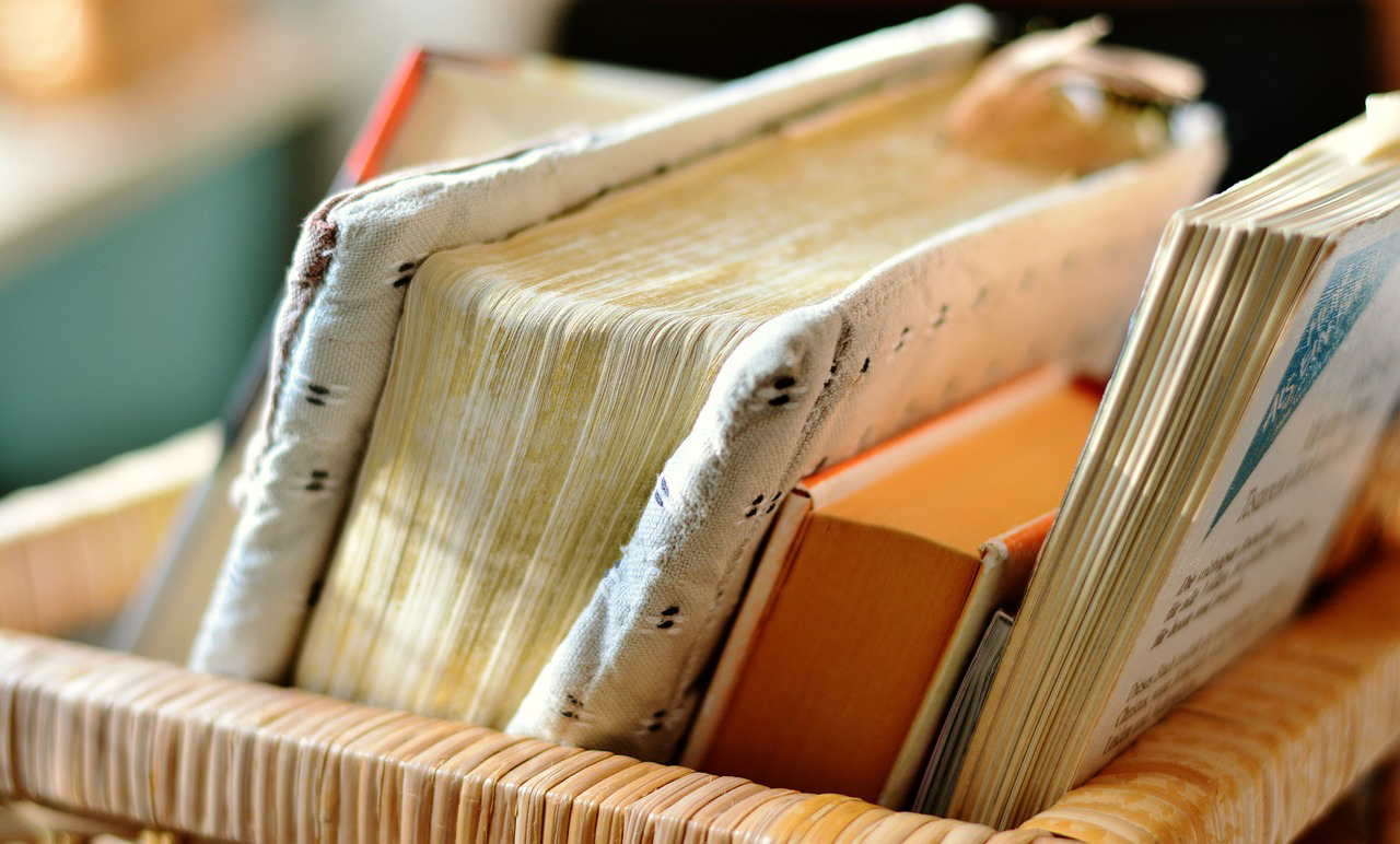 Books in a basket with warm sunlight