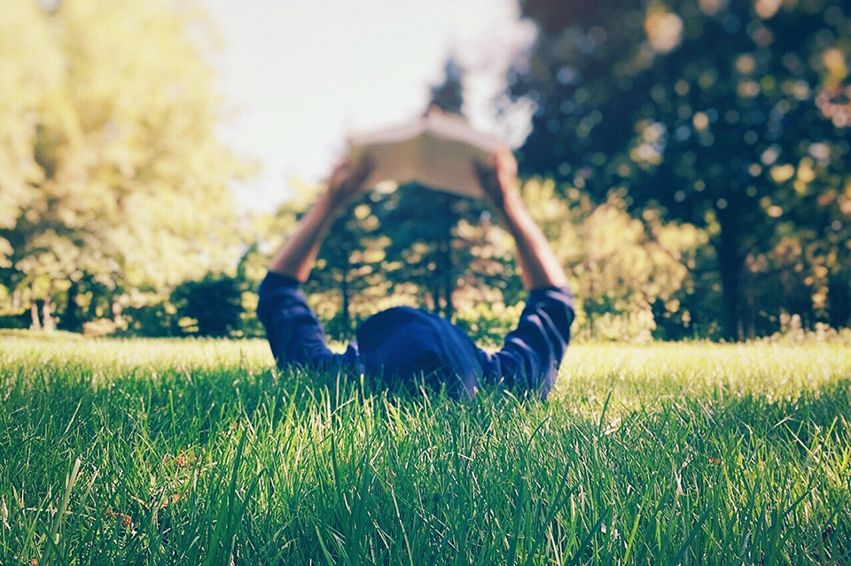 Person reading in the grass