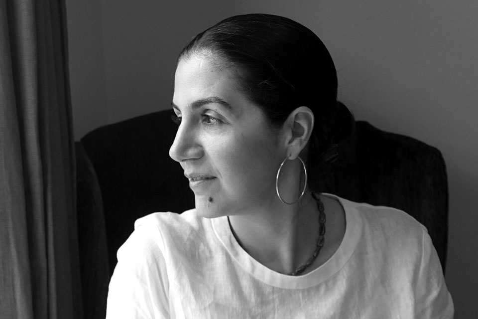 A black and white photograph of Poupeh Missaghi