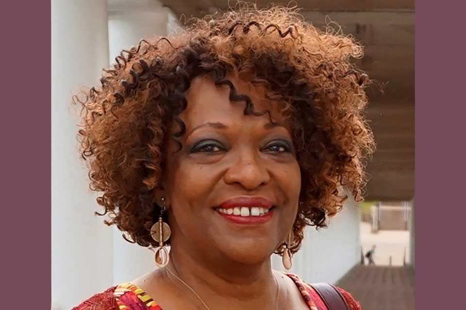 A photograph of Rita Dove, who is smiling while looking at the photographer