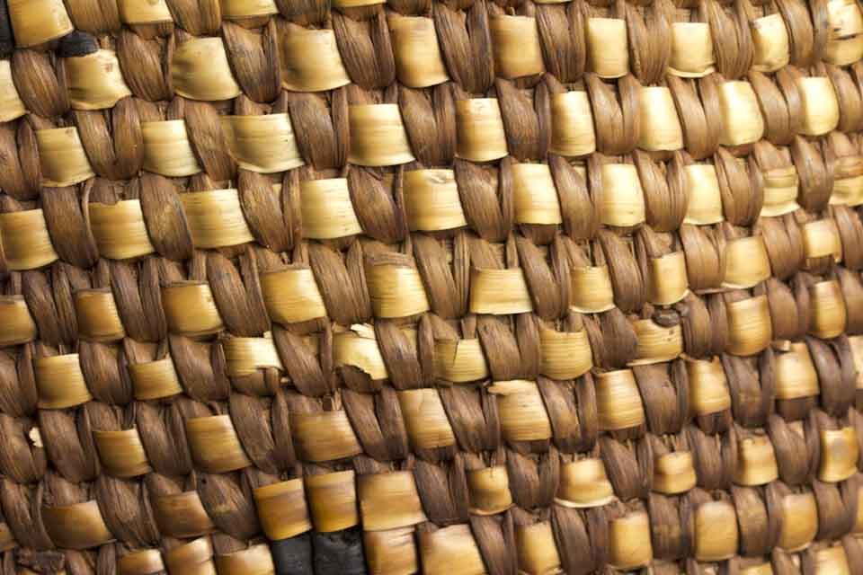 A close-up photograph of a woven basket
