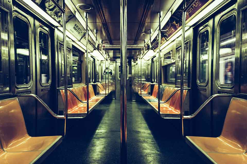 A photograph of the long interior of a subway car
