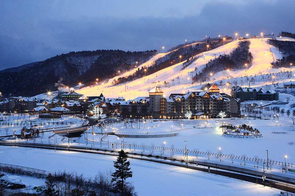 A snowy hillside landscape with the city of PyongCheong at its base.