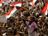 A girl waves the Egyptian national flag as thousands of demonstrators participate in antigovernment protests, February 8, 2011. Photo: Felipe Trueba / EPA / Thinking Images v.9