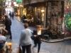 People walking through Finders Lane