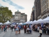 The vendor booths line up in downtown Brooklyn, right in  front of Brooklyn Borough Hall.