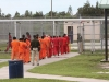 A group of detainees in orange jumpsuits at the Krome Detention Center. Photo: Getty Images