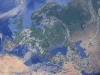 A detail of the Earth from space focused on Europe and Central Asia