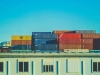 Stacks of shipping containers in primary colors