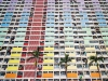 A photograph looking up the front of a colorful apartment building