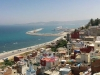A highway stretches along the sea as Tangiers rises up on the hillside bordering