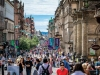 A photograph of a busy street, filled with people, in Glasgow