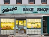 """An illustration of a store front. The sign above reads, """"Glaser's Bake Shop"""""""