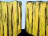 A painting of two tall cliffs, rendered in yellow