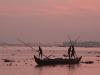 Fishermen work before dawn on the coast off of Kerala