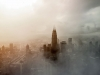 A digital altered photograph of Kuala Lumpur shrouded in fog or smog with greys and browns mixed into the haze