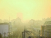 A Tokyo sunrise, the city bathed in dust