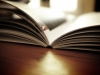 Open book on a desk in sunlight