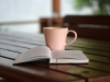 Coffee and a book on a table