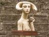 A sculpted bust of the minotaur, who seems boyish and frail