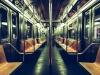 A photograph of the long interior of a subway car