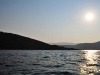 A photograph of a sunrise over the waters off of Ithaca in Greece
