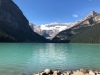 Snow-capped mountains frame a lake