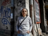 A photograph of Elvira Hernández standing in an urban landscape