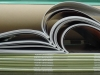 Stack of WLT magazines